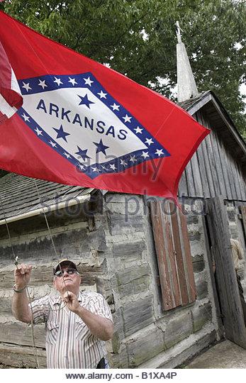 Arkansas Maynard Maynard Pioneer Museum and Park log church regional heritage man senior historic preservation raises - Stock Image