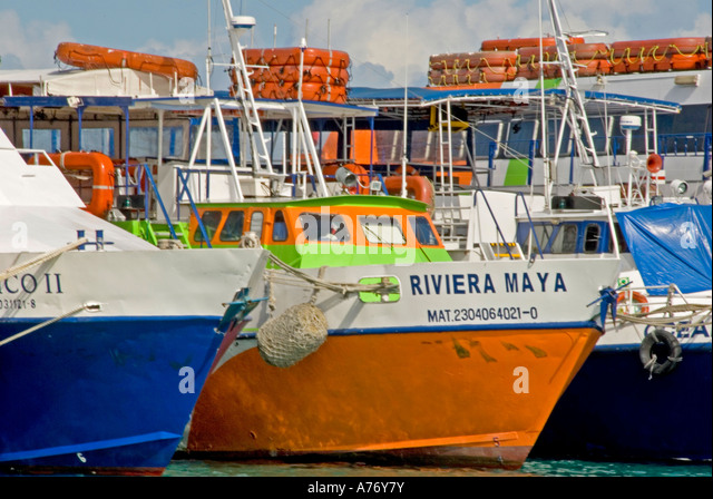 Cozumel Mexico San Miguel town tour boats tied at pier dock - Stock Image