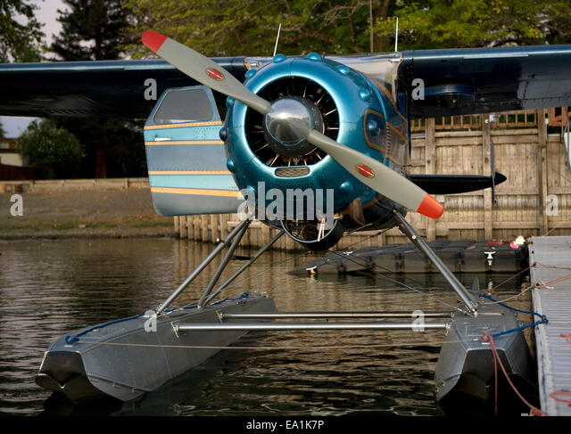 Cessna 195 on floats docked at the Skylark Motel dock, Seaplane Splash-In, Lakeport, California, Lake County, California - Stock Image