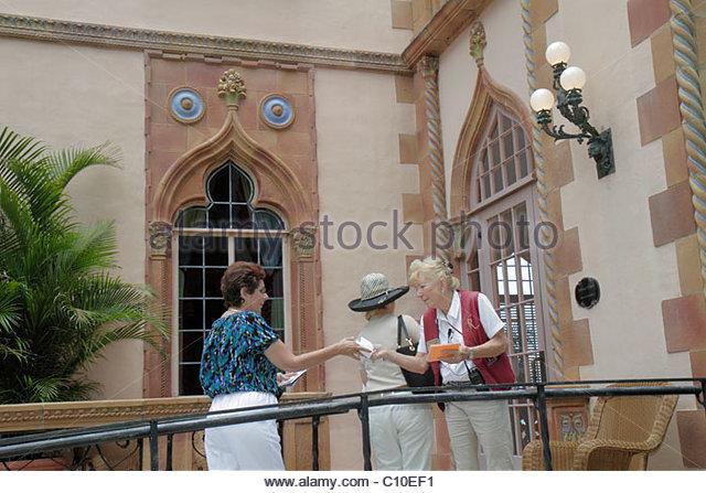 Sarasota Florida John and & Mable Ringling Museum of Art estate Ca d' Zan Mansion senior woman guide Venetian - Stock Image