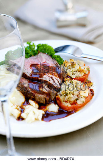 Roast beef with stuffed tomatoes - Stock Image