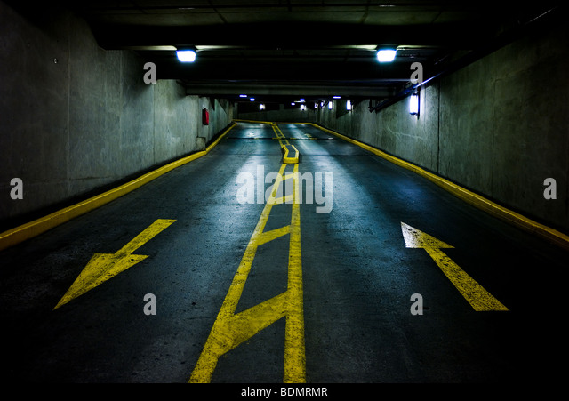 Up and down arrows in a multi-story parking lot garage - Stock Image