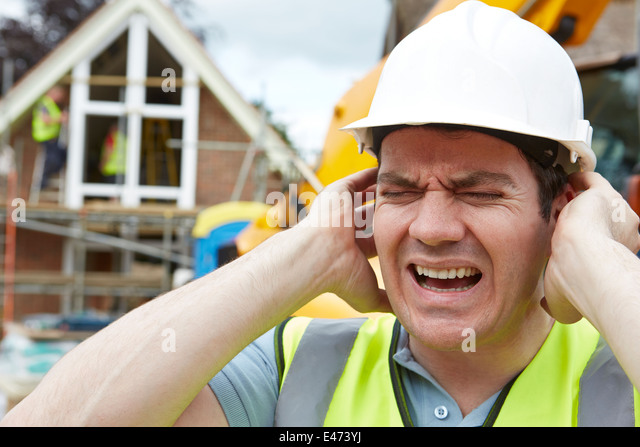 Construction Suffering From Noise Pollution On Building Site - Stock Image