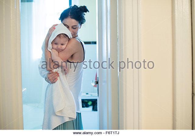 Caucasian mother hugging son in bathroom - Stock-Bilder