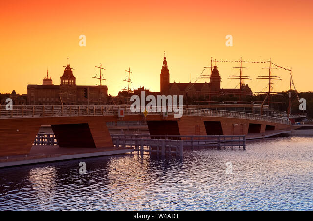 Beautiful sunset over Szczecin (Stettin) City skyline with silhouettes of buildings and ships, Poland. - Stock Image
