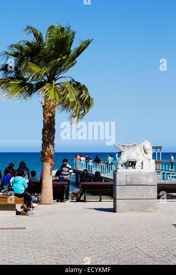 Statue and pier, Finikoudas, Larnaca, Cyprus - Stock Image