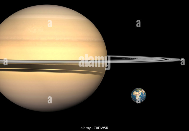 Illustration of Saturn and Earth to scale. - Stock Image