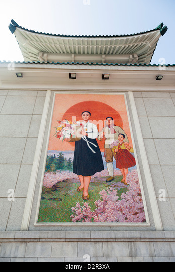 Colourful wall paintings outside the National Theatre, Pyongyang, North Korea - Stock Image