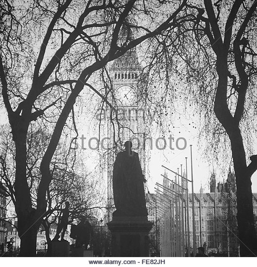Low Angle View Of Statue Against Big Ben At Parliament Square - Stock-Bilder