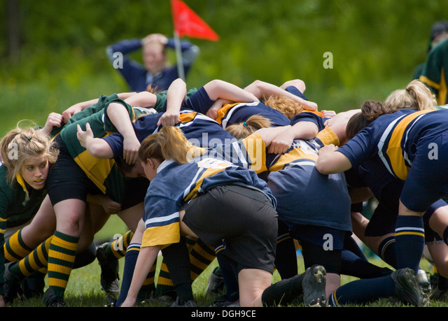 girls in rugby scrum - Stock Image