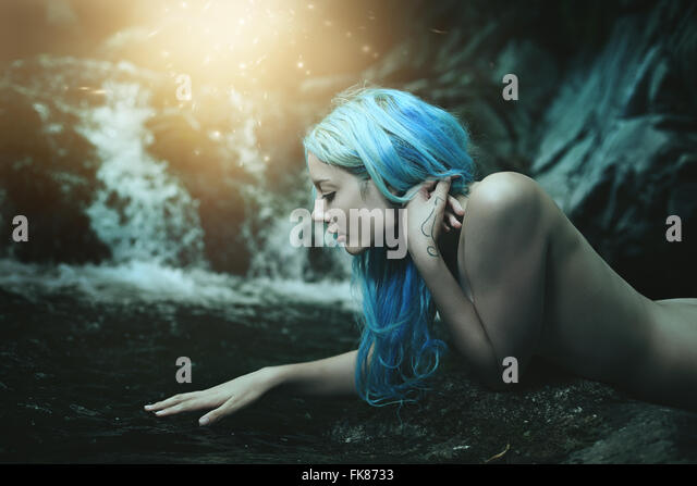 Water nymph surrounded by magical lights . Fantasy and myth - Stock Image