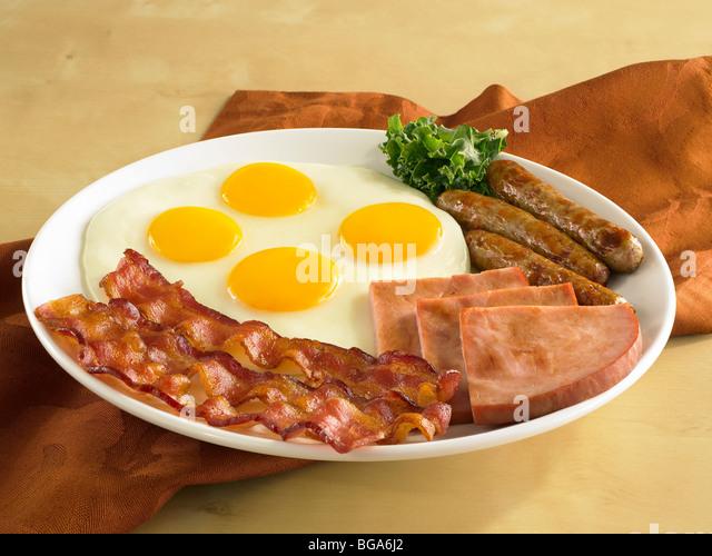 Bacon egg sausage ham breakfast - Stock Image