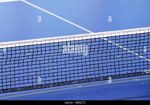 table tennis net and blue table - Stock Image