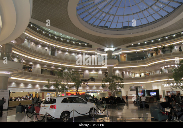 Georgia Hartsfield-Jackson Atlanta International Airport ATL concourse Atrium restaurants shopping concessions skylight - Stock Image