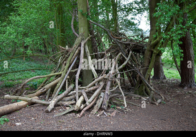 Children's den or tent made of discarded branches - Stock Image