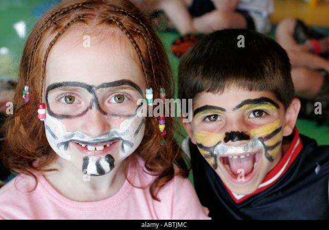 Puerto Rico Atlantic Ocean Holland America Line ms Noordam Club HAL children painted faces - Stock Image