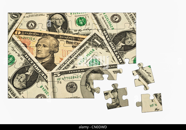 Puzzle:  Detail photo of various U.S. American dollar bills - Stock Image