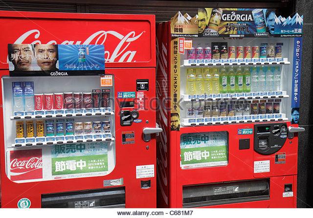 Tokyo Japan Shinjuku drugstore pharmacy kanji hiragana katakana characters symbols Japanese English retail display - Stock Image