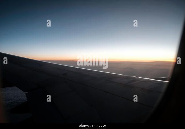 view airplane window clouds dramatic seat travel - Stock-Bilder