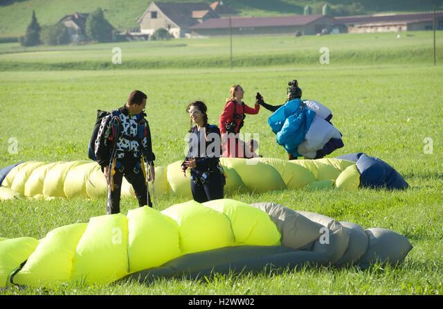 Happy poeple after happy landings - Stock Image
