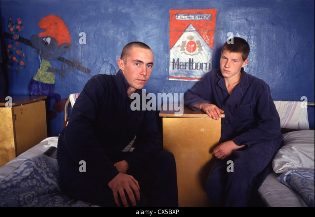 Teenage boys sit on their beds at the Udmurtia Educational Colony, a juvenile prison colony in Mozhga, Russia. - Stock Image