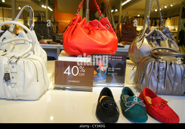 Maine Freeport Main Street Route 1 outlet store shopping fashion retail display for sale Cole Haan shoes handbags - Stock Image