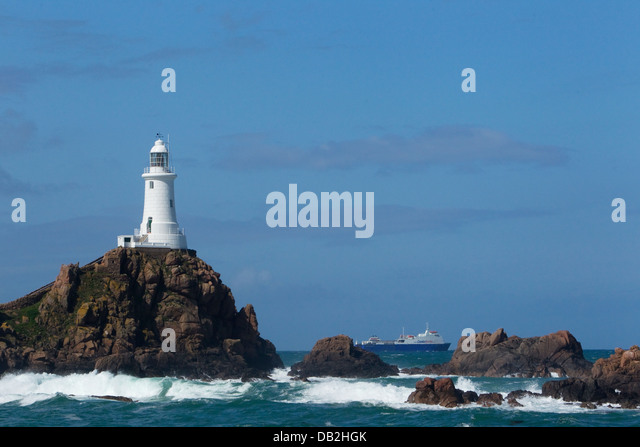 Corbiere Lighthouse and fast ferry to mainland Jersey Channel Islands, UK LA005944 - Stock Image
