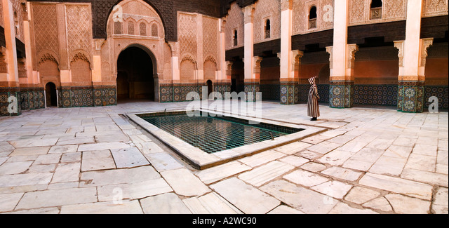 Muslim man dressed in traditional Jellaba in the courtyard of the Ali ben Youssef Medersa Model released Marrakesh - Stock Image
