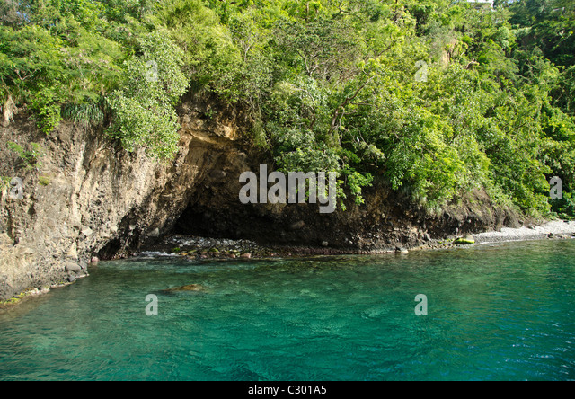 St Vincent island rocky coastline with a cave flooded by Caribbean sea - Stock Image