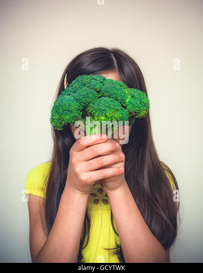 Young girl with brown hair acting - Stock Image