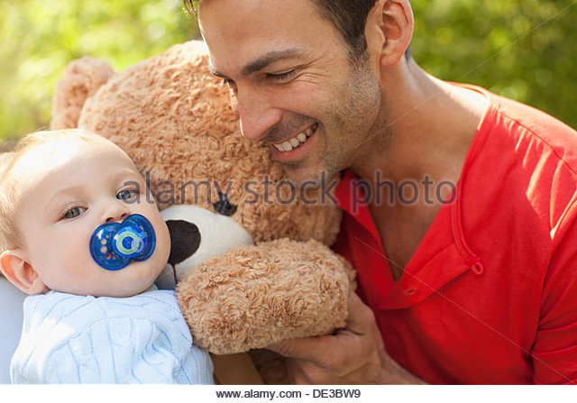 Father and baby with teddy bear - Stock Image