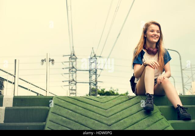 Teenager Girl Sitting Stairs Concept - Stock Image