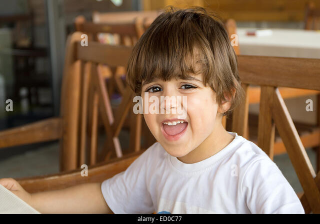 Angry boy (2-3) making a face - Stock Image