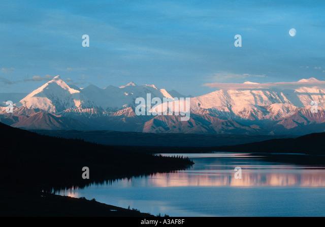 Denali National Park Alaska USA Mt Brooks and the Alaska Range reflection Sunset Pond Wonder Lake area Sunrise Moonset - Stock Image
