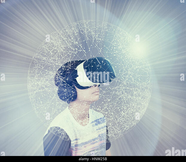 Mixed Race boy wearing virtual reality goggles in glowing sphere - Stock-Bilder