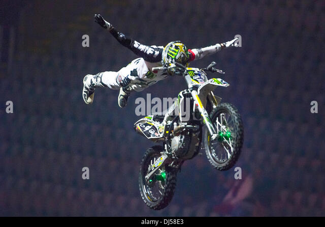 Oslo, Norway. 21st November 2013. Blake Bilko Williams does a super man freestyle motocross trick during the Nitro - Stock Image