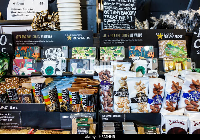 Palm Beach Florida Gardens Starbucks Coffee cafe interior sale display protein bars nuts - Stock Image