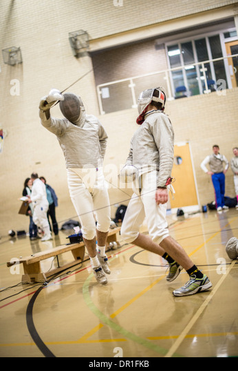 Two male men Aberystwyth university students fencers competing at fencing, sabre style, UK - Stock Image