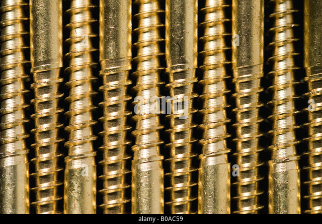 Screws lined up, extreme close-up - Stock Image