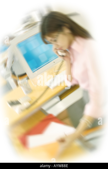 Woman talking on the phone in the office - Stock-Bilder