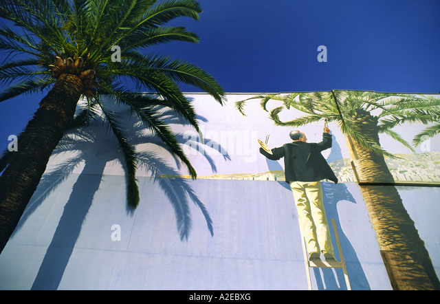 France Nice wall painting palm tree blue sky - Stock Image