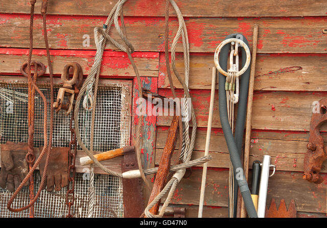 Rust covered stock photos rust covered stock images alamy for Wall fishing tools