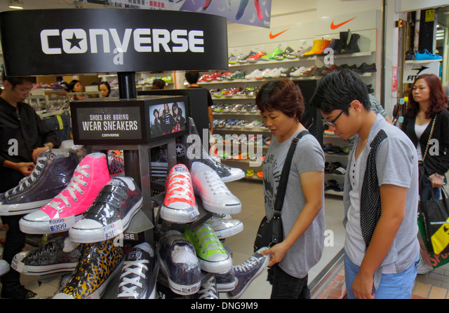 Hong Kong China Kowloon Mong Kok Fa Yuen Street Sneaker Street shopping fashion athletic shoe store inside Converse - Stock Image