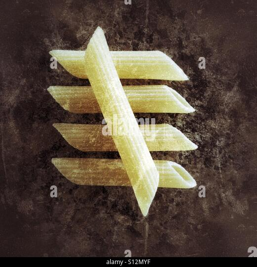 Five penne noodles (part of a number series). - Stock Image