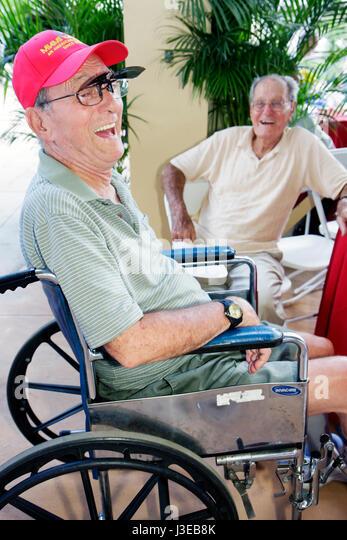 Miami Florida Tropical Park Cuban Exodus Relief Project festival political Hispanic man men senior wheelchair disabled - Stock Image