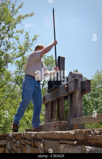 A docent opens the mill race to the country mill at Aldie, Virginia. - Stock Image