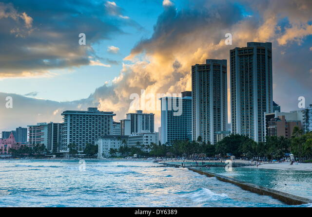 Late afternoon light over the high rise hotels of Waikiki Beach, Oahu, Hawaii, United States of America, Pacific - Stock Image