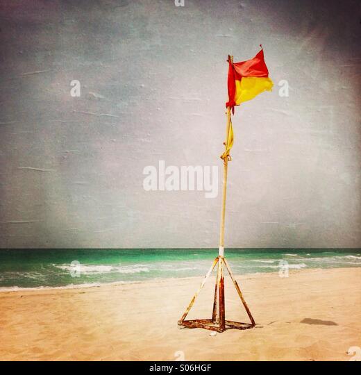 Safety flag on the beach. Abu Dhabi, UAE - Stock Image