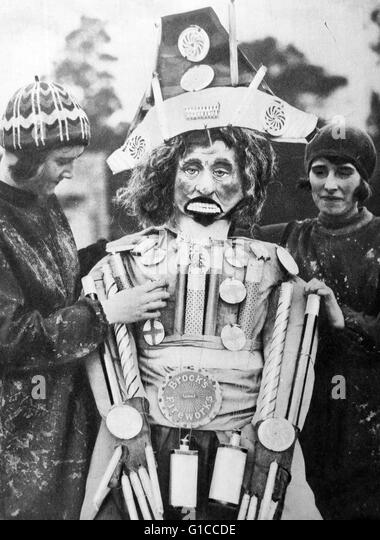 1920's Guy Fawkes Night; preparing a guy made up from fireworks. also known as Guy Fawkes Day, Bonfire Night - Stock Image