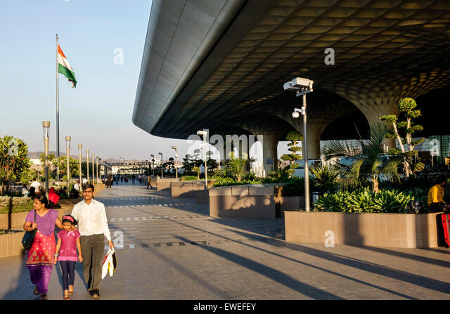 Mumbai India Indian Asian Chhatrapati Shivaji International Airport front entrance woman mother man father girl - Stock Image
